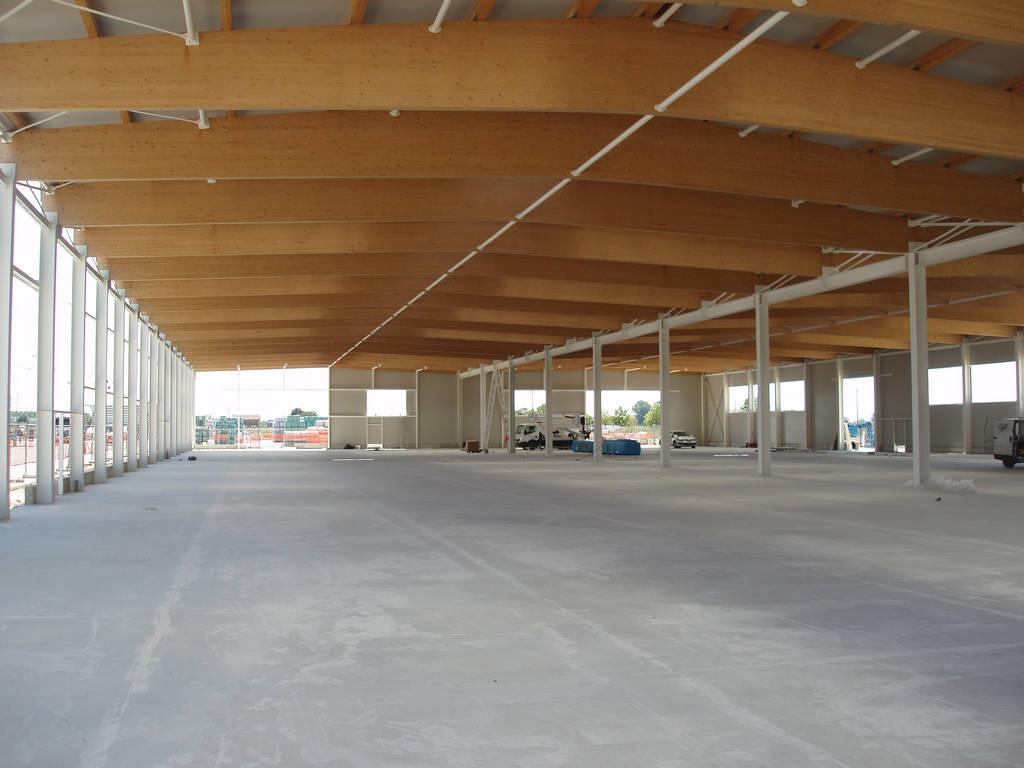 Aree commerciali sistem costruzioni for Capannoni in legno prezzi